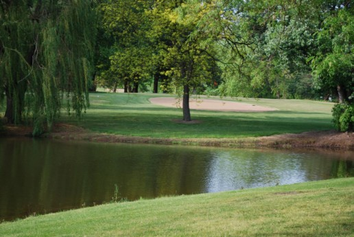 Lake running through golf course.